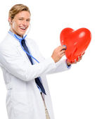 Happy young Doctor holding heart isolated on white background — Stock Photo