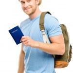 Happy young tourist man holding passport white background — Stock Photo