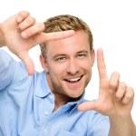 Happy man framing photograph — Stock Photo #27403269
