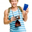 Happy tourist holding passport retro camera isolated on white — Stock Photo