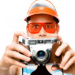 Happy tourist photographer taking photograph retro geek man lati — Stock Photo #27404113