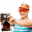 Happy tourist photographer taking photograph retro geek man lati — Stock Photo #27404455
