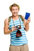 Szczęśliwy turysta posiadający paszport retro aparat na białym tle — Zdjęcie stockowe