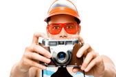 Happy tourist photographer taking photograph retro geek man lati — Stock Photo