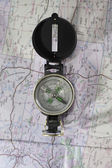 Compass over a map — Stock Photo