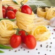 Raw pasta with tomatoes and cheese — Stock Photo