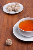 Tea and truffles — Stock Photo