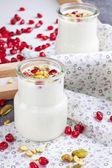 Yogurt in small glass jar — Stock Photo