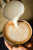 Coffee latte art with milk — Stock Photo