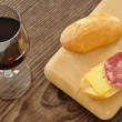 Italian snack with bread, salami, cheese and red wine — Stock Photo #14123046