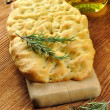 Focaccia with rosemary and olive oil - Stock Photo