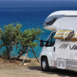 Stock Photo: Camper parked on beach