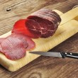 Bresaola on a cutting board - Stock Photo