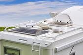 Camper, solar panel, antenna TV porthole — Stock Photo