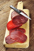 Bresaola on a cutting board — Stock Photo