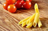 Italian penne pasta with tomato — Stock Photo
