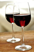 Two glass of fine Italian red wine on a table in oak — Stock Photo