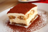 Tiramisu cake on the plate — Stock Photo