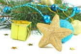 Christmas composition with gold star and gift over white — Stock Photo