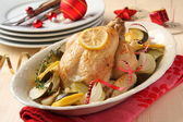 Roasted whole chicken with christmas decoration — Stock Photo