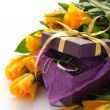 Stock Photo: Yellow roses and purple gift box with jewelry