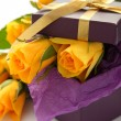 Stock Photo: Yellow roses and purple gift box