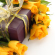 Yellow roses and purple gift box — Stock Photo