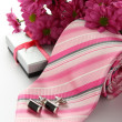 Tie and cuff links with flowers over white — Stock Photo #19388631