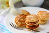 Dutch mini pancakes called poffertjes — Stock Photo