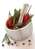 Fresh rosemary and red pepper in metal mortar with pestle — Stock Photo
