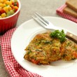 Homemade zucchini fritters with chorizo sausage and corn salsa — Stockfoto