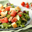 Stock Photo: Salad with meat, cucumbers, tomatoes and croutons