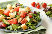 Salad with meat, cucumbers, tomatoes and croutons — Stock Photo