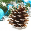 christmas composition with pinecone and blue ball over white — Stock Photo