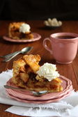 Slice of homemade dutch apple cake with whipped cream — Stock Photo