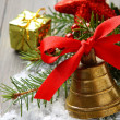 Golden bell with red satin ribbon bow — Stock Photo #32286529