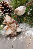 Christmas composition with star and branch of christmas tree — Stockfoto