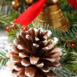 Stock Photo: Pinecone with christmas decoration and snow