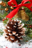 Pinecone with christmas decoration and snow — Stock Photo