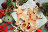 Homemade christmas elk-shaped cookies with christmas decoration. — Stock Photo