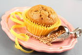 Freshly baked buckwheat muffins on the rose plate — Stock Photo