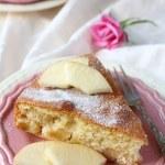 Slice of homemade apple sponge cake on pink plate — Stock Photo #41610885