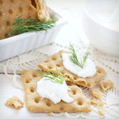 Snack gluten free crispbread with cream cheese and dill — Stock Photo