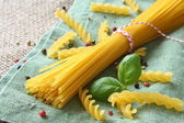 Uncooked gluten free pasta from blend of corn and rice flour — Stock Photo