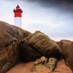 Lighthouse on Rocks — Stock Photo