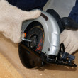 Setting the blade of the circular saw — Stock Photo