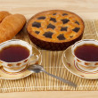 Tea composition with blue poppy pie and two croissants — Stock Photo