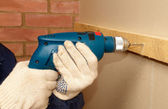 Drilling the wooden panel — Stock Photo