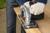Wood cutting with circular saw — Stockfoto