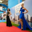 Models posing at Olympus stand - Stock Photo